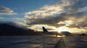 silhouette of airplane in golden hour
